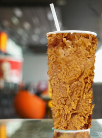 A drink cup made from fried chicken will soon be available at KFCs nationwide.
