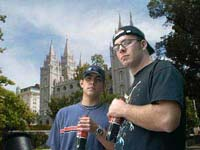 Jacob Hensdale and Mark Richards stand outside the Mormon temple in Salt Lake City defiantly, with Cokes in hand.